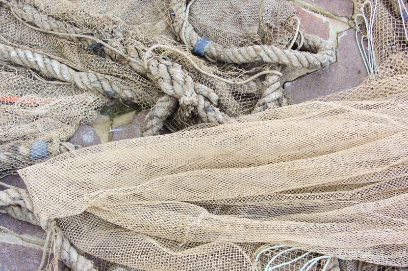 Använt fisknät med floaters arkivbilder