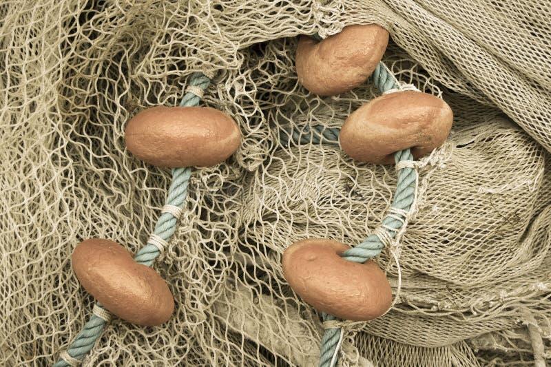 Använt fisknät med floaters royaltyfria foton