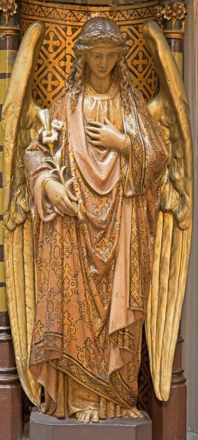 Anvers - ange polychrome découpé de pupitre de Joriskerk ou d'église de St George photo libre de droits