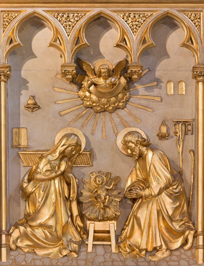 Anvers - soulagement de nativité. du cent 19. dans l'autel de Joriskerk ou d'église de St George photographie stock libre de droits