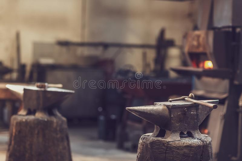 Anvil and hammer in a metal workshop royalty free stock photo