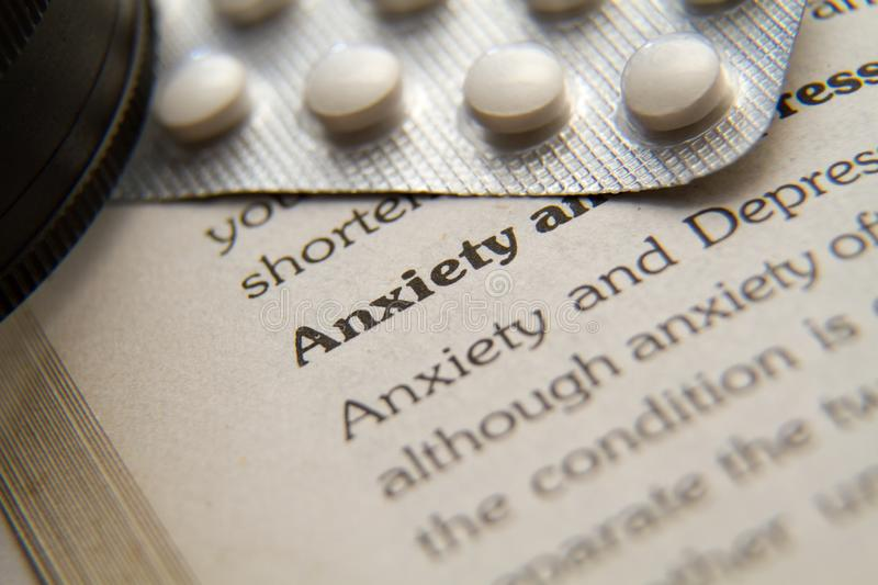 Anxiety and Depression Definition and Medicine depicting the idea. Tablets on book royalty free stock images
