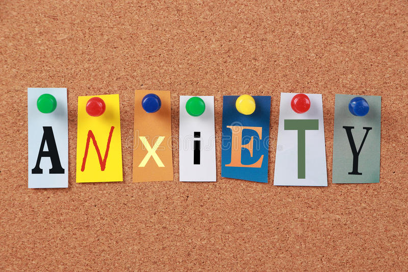 Anxiety Single Word. The word Anxiety in cut out magazine letters pinned to a corkboard royalty free stock photography