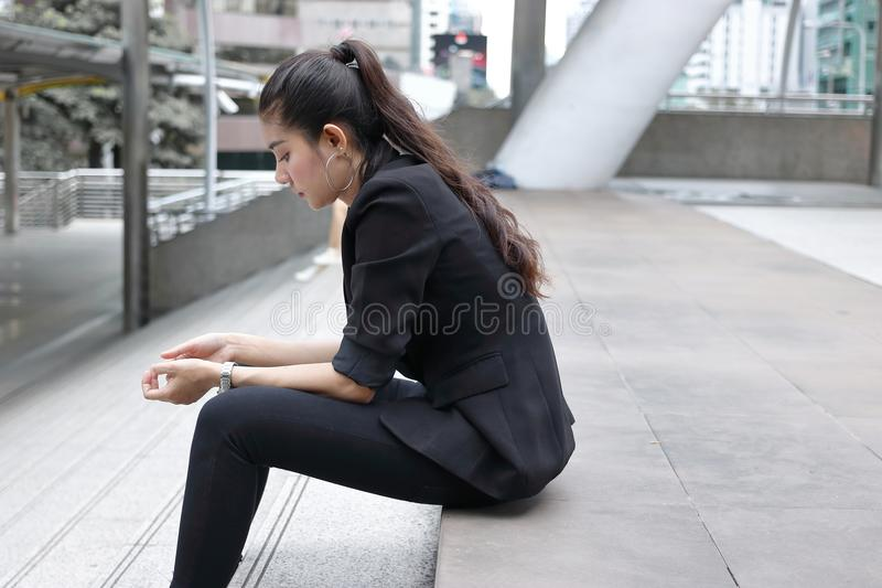Anxiety stressed young Asian business woman in depression royalty free stock images