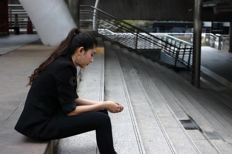Anxiety stressed young Asian business woman in depression royalty free stock image