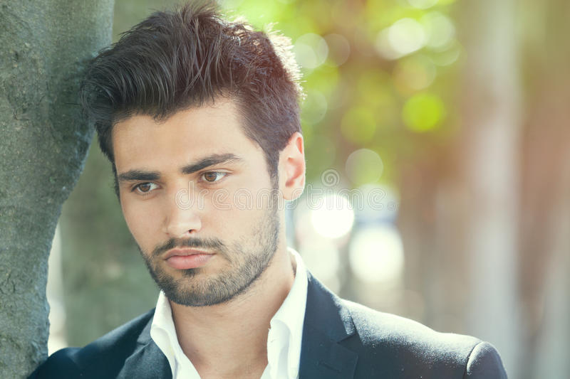 Anxiety and thoughts of young and handsome man stock photo