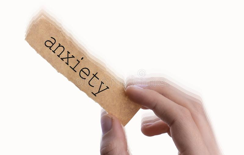 Anxiety wording on blank torn notepaper in hand royalty free stock photos