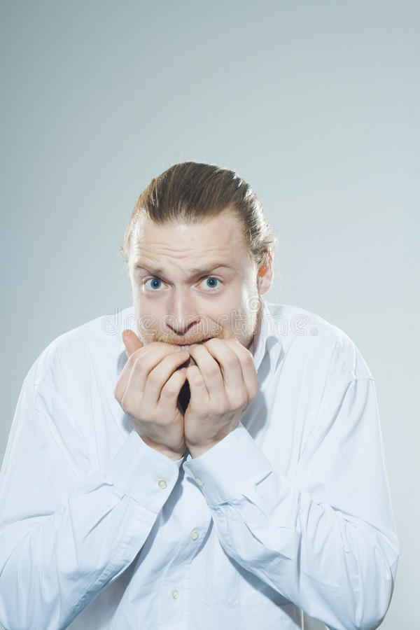 Download Anxious Man Chewing On Fingernails Stock Photo - Image of hair, economy: 39501024