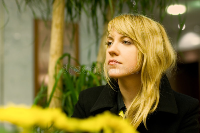 Anxious Professional Woman. Waiting in a hotel lobby, caucasian woman, 31yrs of age, slightly tired of waiting royalty free stock photography