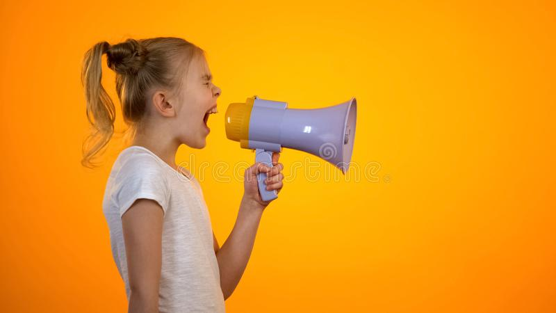 Anxious teen girl shouting in loudspeaker, relieving stress, children rights stock image