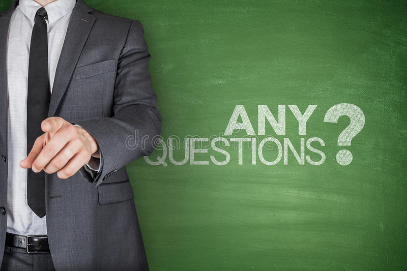 Any Questions concept on green Blackboard stock photography