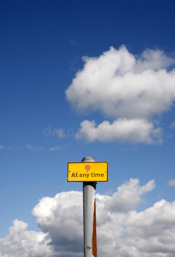 Download At Any Time Sign Against A Blue Sky Stock Image - Image: 32881745
