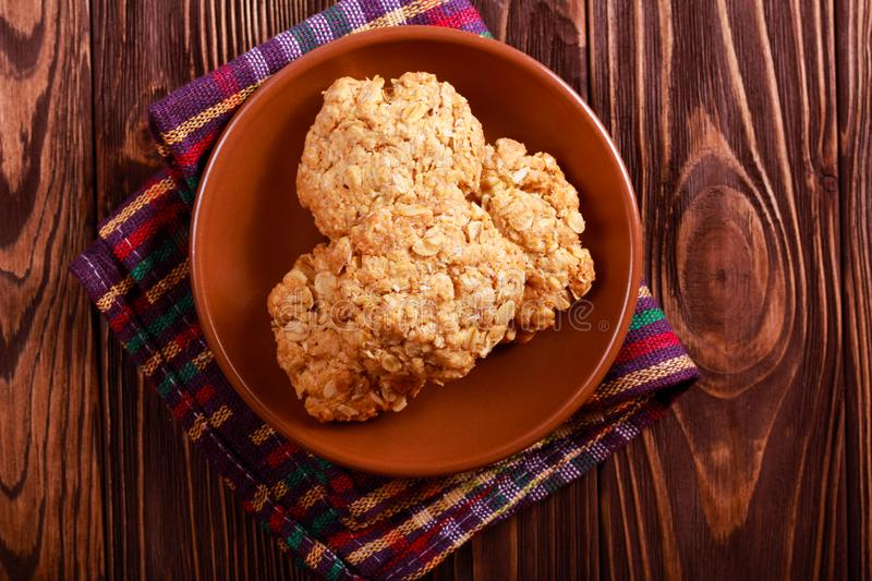 Anzac biscuits on brown plate stock photo