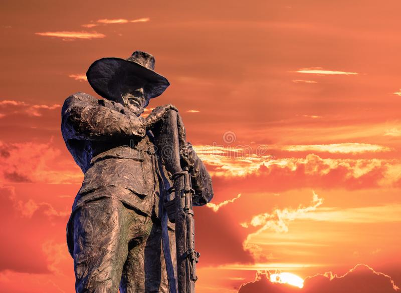 Anzac bridge monument of soldier with a sunset sky. Lest we forget. Anzac Day. Remembrance day stock image