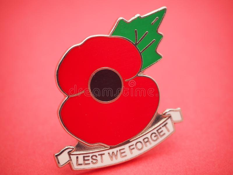 ANZAC Day 2018. ANZAC Day 25 April 2018 no text on light red background with focus fade on , with large picture of the universal generic medal badge of poppy stock images