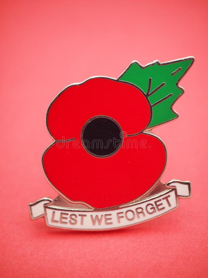 ANZAC Day 2018. ANZAC Day 25 April 2018 with no text on light red background with focus fade on , with large picture of the universal generic medal badge of royalty free stock image