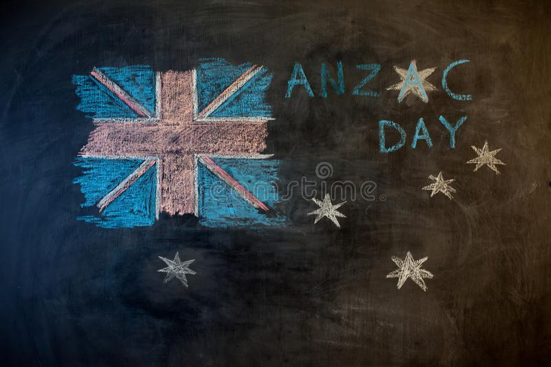 ANZAC Day text cut out over photo of Australian flag. royalty free stock photo