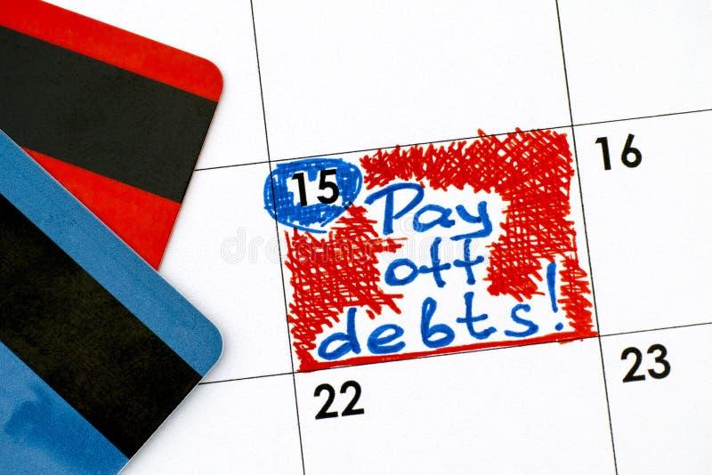 Anzeige zahlen weg Schulden im Kalender mit Kreditkarten lizenzfreie stockbilder