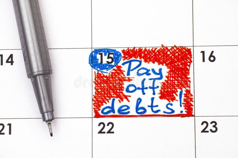 Anzeige zahlen weg Schulden im Kalender mit Stift stockbilder