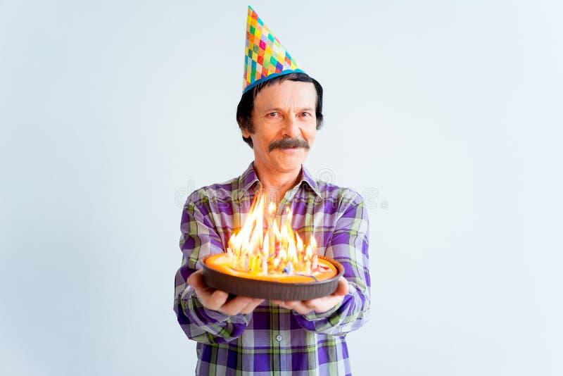 Anziani su una festa di compleanno fotografia stock libera da diritti