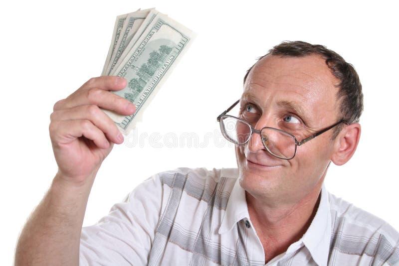 Anziano con soldi fotografia stock libera da diritti