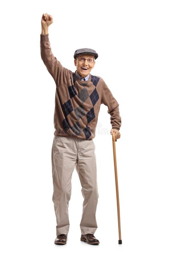 Anziano con una canna che gesturing felicità immagini stock libere da diritti