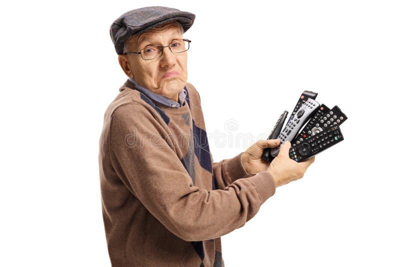 Anziano confuso che tiene un mazzo di riprese esterne immagini stock libere da diritti