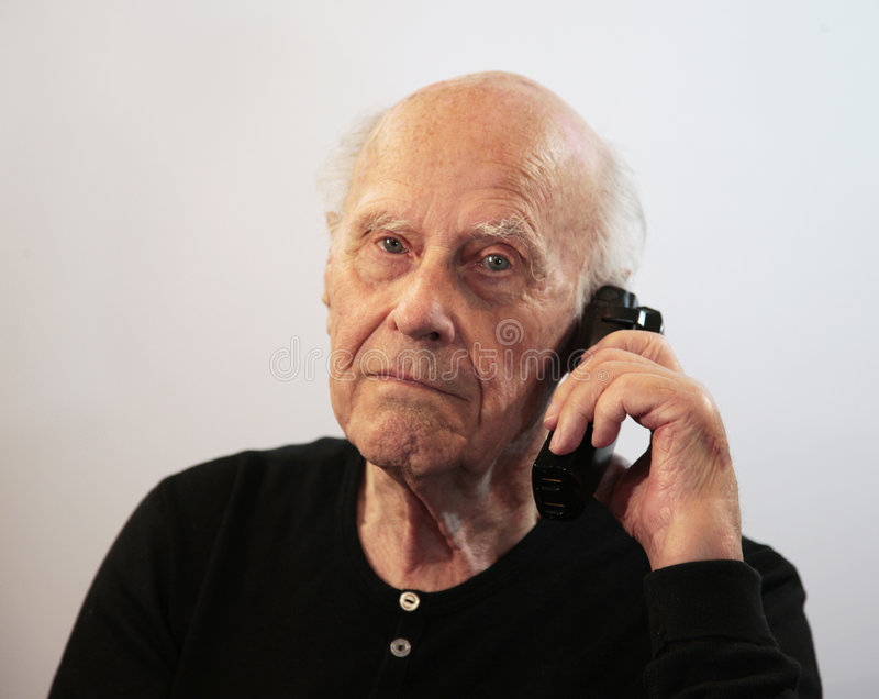 Anziano sulla chiamata fotografie stock libere da diritti