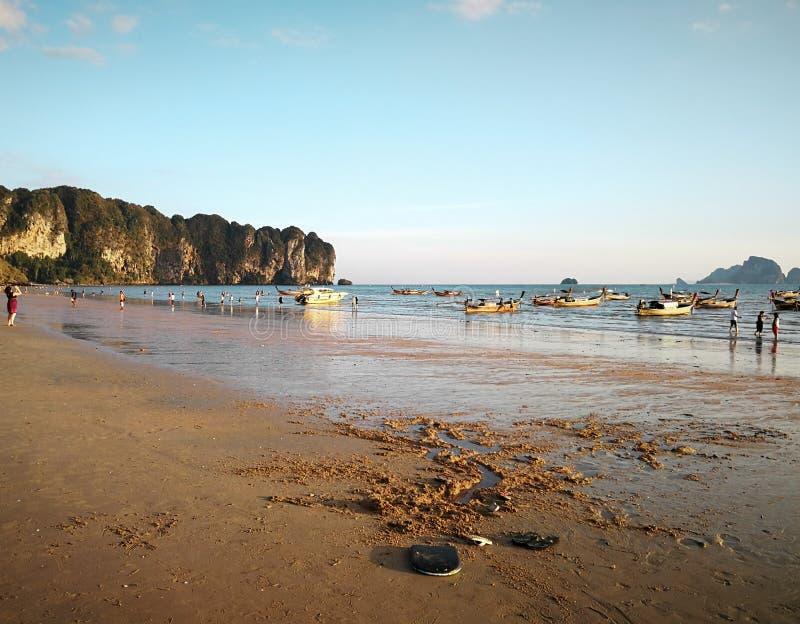 AO NANG BEACH, KRABI PROVINCE, THAILAND - MARCH 16, 2018: Tourists relaxing on Ao Nang beach, Krabi province, Thailand royalty free stock photos