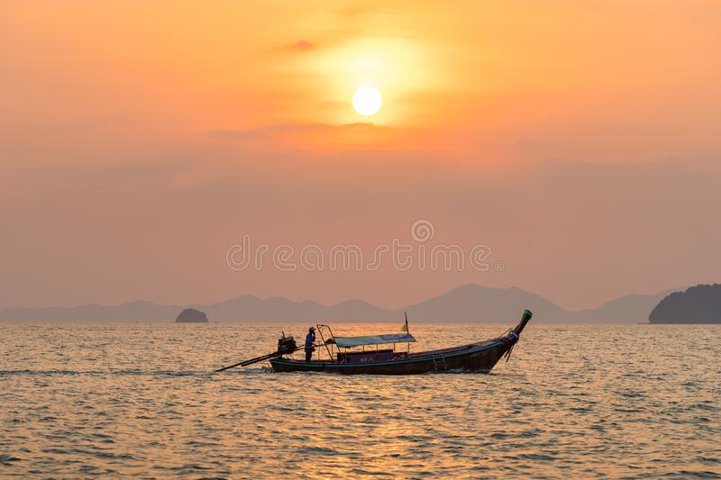 Local fisherman float on thai longtail boat in the sea water at beautiful royalty free stock images