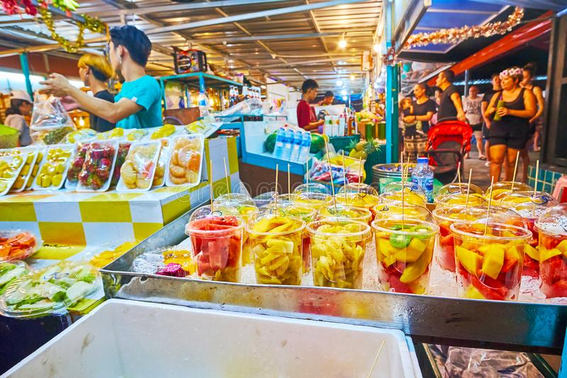 Fruit salads in Night Market, Ao Nang, Krabi, Thailand. AO NANG, THAILAND - APRIL 25, 2019: Choose the tropical fruit salads or fresh cocktails in a stall of stock photos