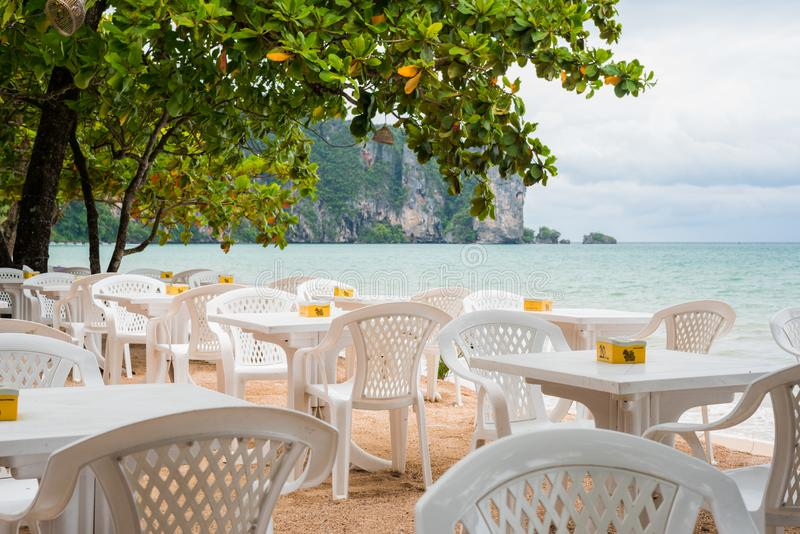 Ao Nang, Thailand: empty tables of an open-air cafe. Summer is the low season in Krabi province so tourist business idles stock photos