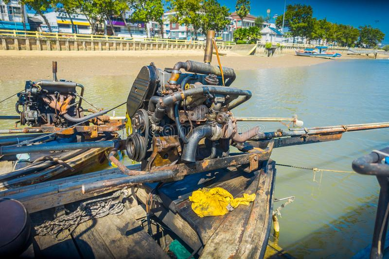 AO NANG, THAILAND - FEBRUARY 09, 2018: Close up of details of the motor boat over a long tail boat with a blurred nature royalty free stock photography