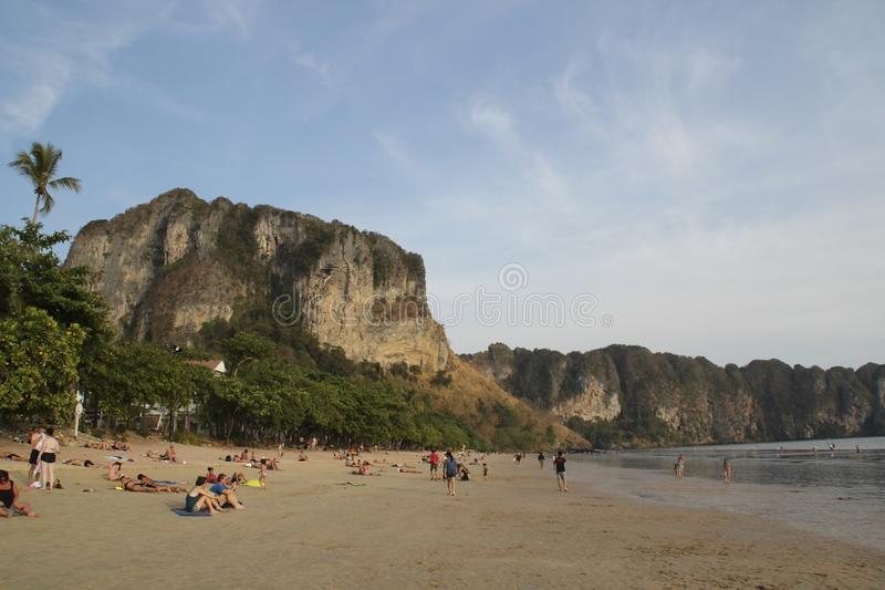 AO NANG, THAILAND, FEBRUARY 10, 2015 : Tourists enjoying the beautiful and wide Railay West beach surrounded by awesome cliffs in stock image