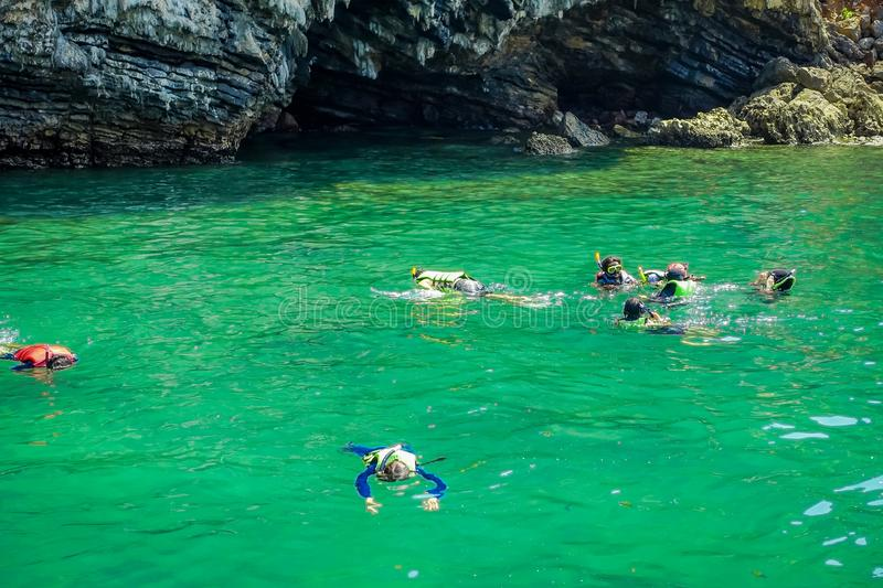 AO NANG, THAILAND - MARCH 05, 2018: Tourists relaxing and swimming in the turquoise water at chicken island in Thailand stock photography