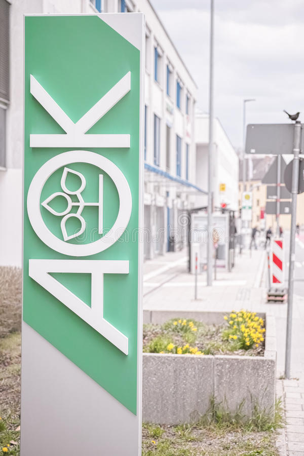 AOK sign. Big sign of the german AOK health insurance in a street - copy space to the right royalty free stock image