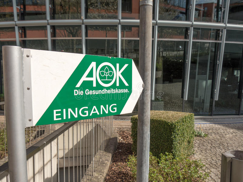 AOK. Sign infront of an office of the german AOK health insurance with lots of copy space royalty free stock photo
