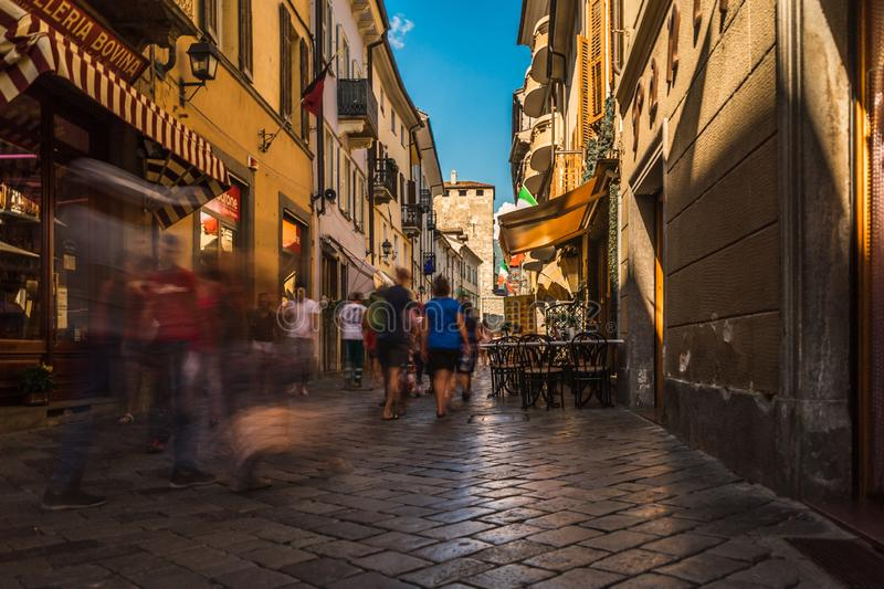 Aosta city center street road people walk fast for shopping. At holiday stock photo