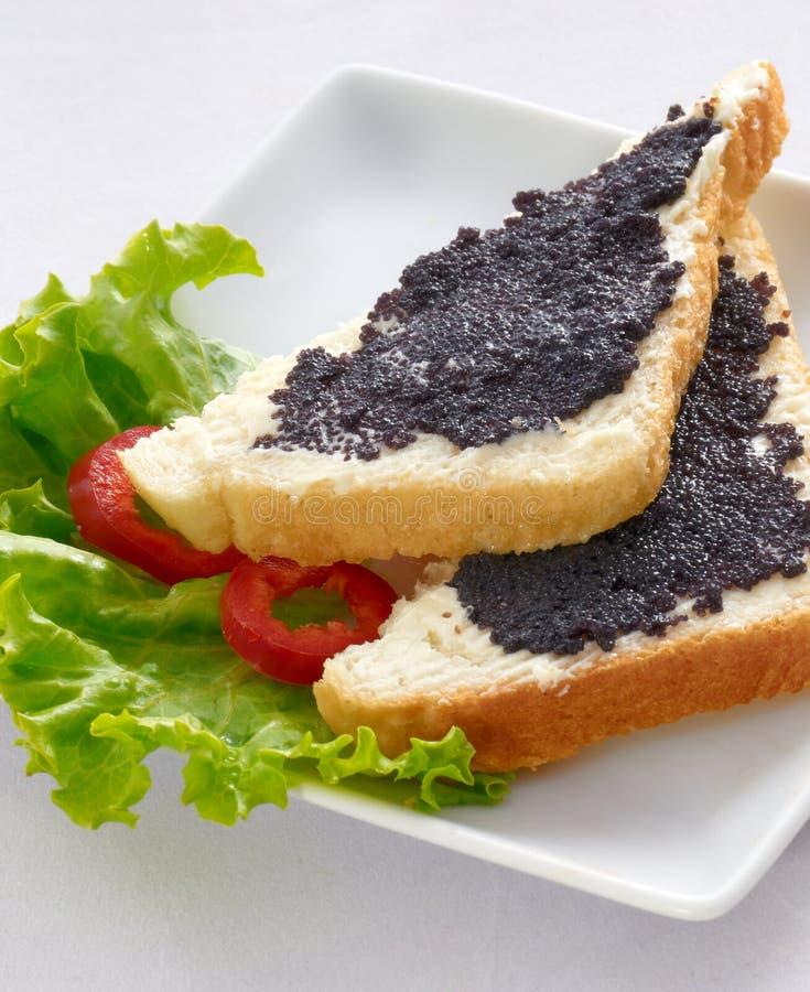 Apéritifs avec le caviar images stock