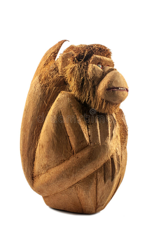 Apa som snidas från en kokosnöt fotografering för bildbyråer
