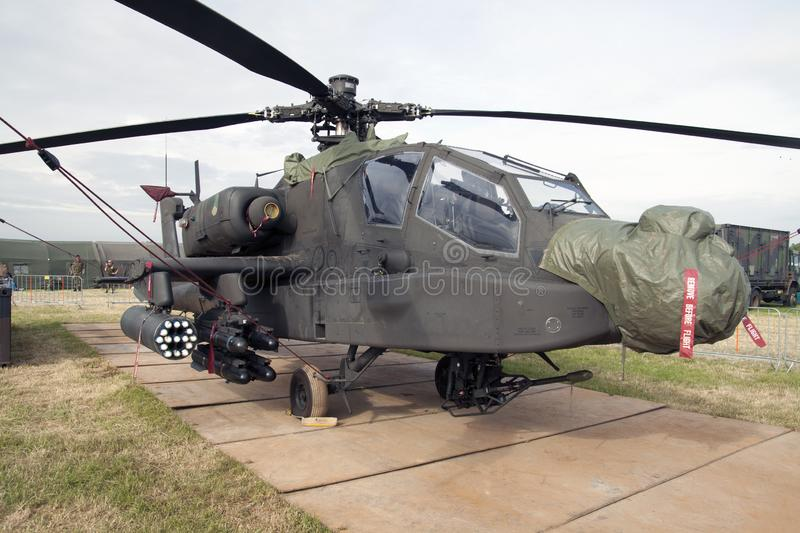 Apache AH-64D combat helicopter made in th eusa. LEEUWARDEN, NETHERLANDS - JUNI 11 2016:Military Apache AH-64D combat helicopter with camouflage colors during royalty free stock photography