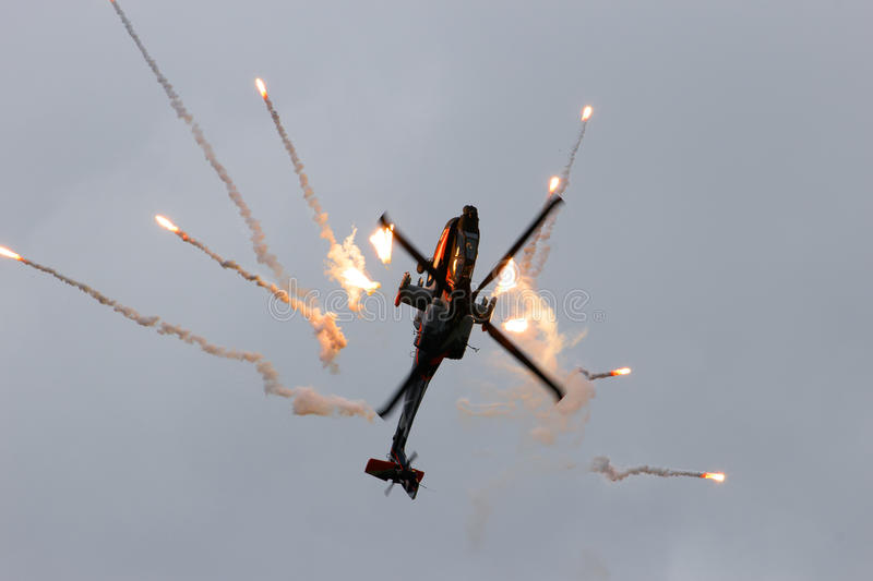 Apache attack helicopter and flares royalty free stock photography