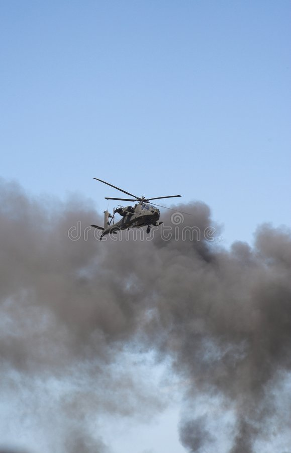 Apache helicopter in a warzone royalty free stock images