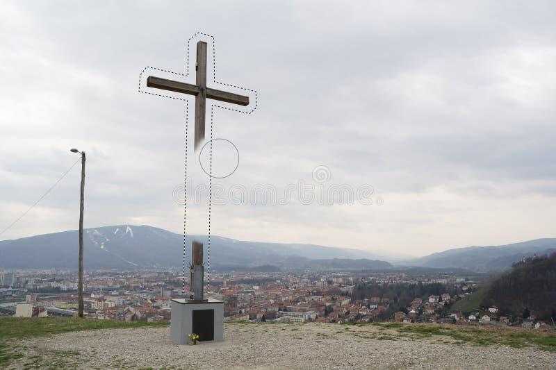 Apagamento da cruz cristã imagem de stock