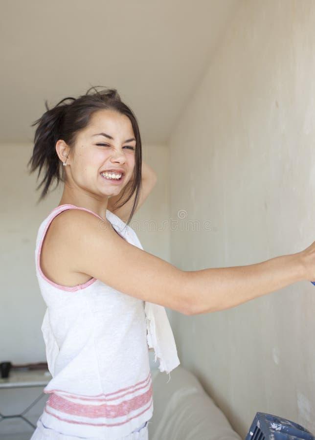Apartamento da pintura da menina fotografia de stock
