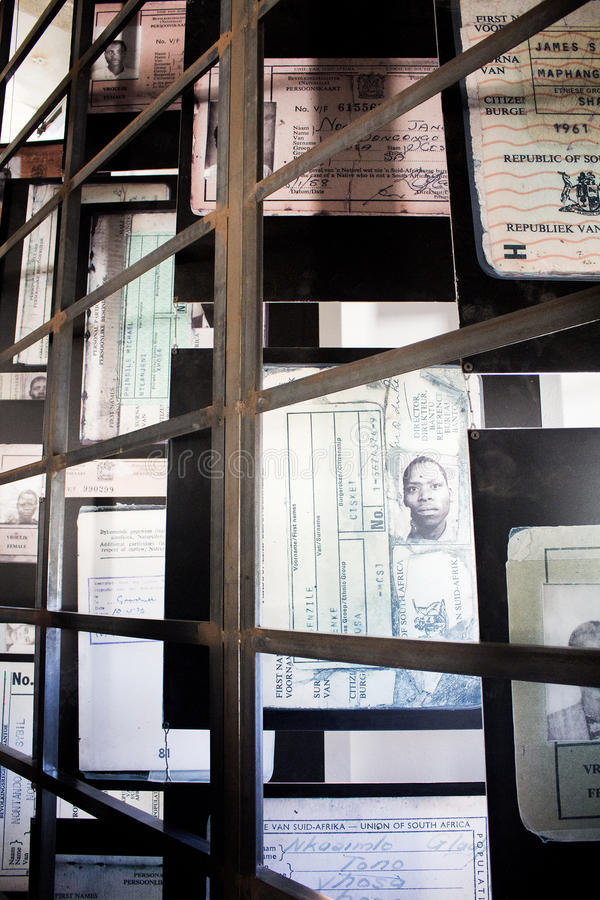 Apartheid Museum exhibition next to rhe entrance. South Africa, Johannesburg - 30 March, 2016: Apartheid Museum, exhibition next to the entrance. ID for whites royalty free stock images