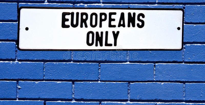 Apartheid sign europeans only blue brick wall stock photos