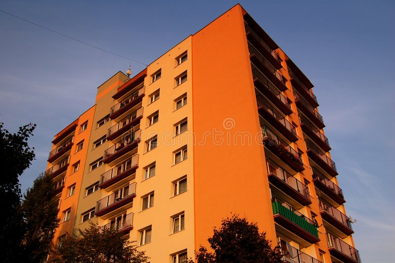 Apartment block. High apartment block with balconies at dusk royalty free stock photo