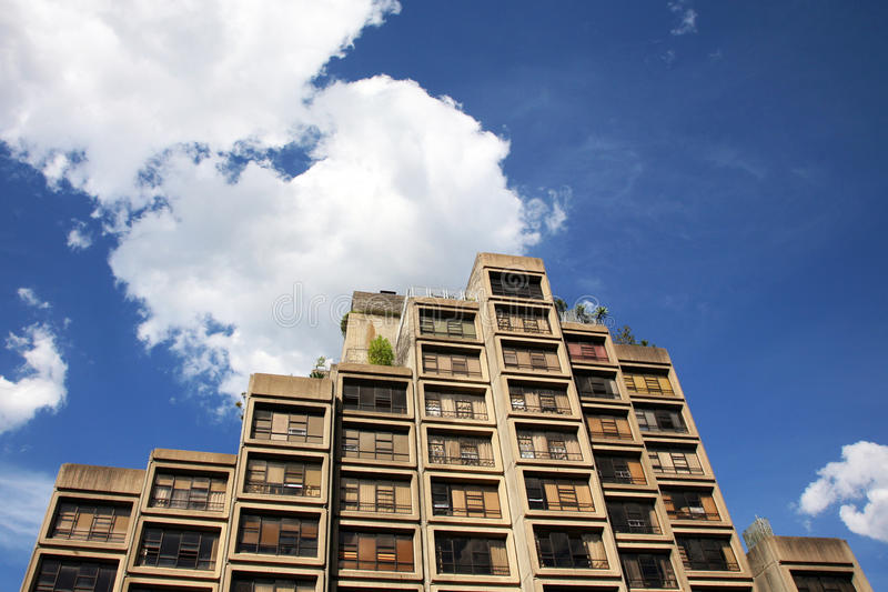 Apartment block. With a cloudy sky royalty free stock photo