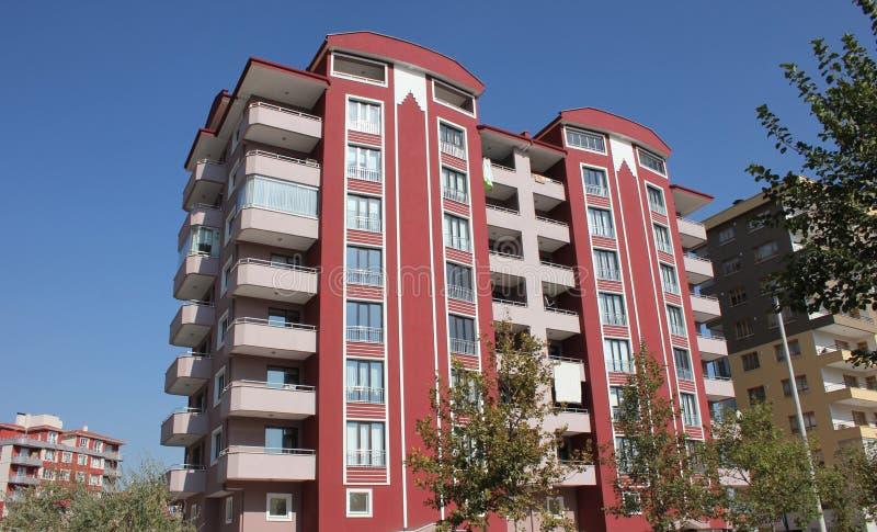 Apartment block. Front view of a modern apartment block stock photos